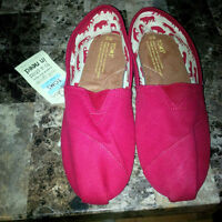 Brand new TOMS with tags size M12 or could fit womans 10.5