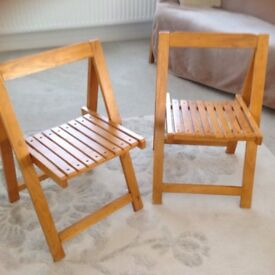 Two lovely sturdy solid wood folding chairs £10 each