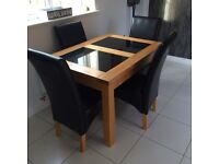 **WOODEN TABLE FAUX LEATHER SEATS**