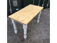 Small pine table with painted legs. Lovely piece of furniture