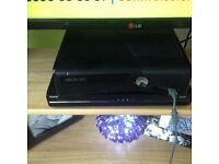 Slim Xbox 360 with games