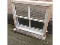 Double glazed sash window with stone cill
