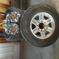 TIRES AND RIMS WITH HUBCAPS AND NUTS