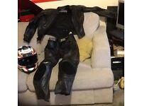 Motorbike leathers with helmet.