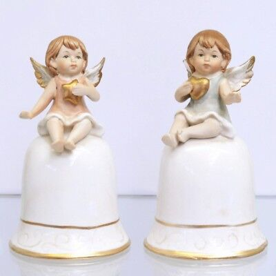 Zwei Tischglocken mit Engelfiguren in Gold und Weiß ()