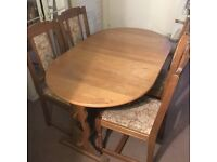 Solid wood dining table (4 seater expands to 6 seater) + 5 chairs