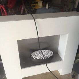 Ivory electric fire with surround