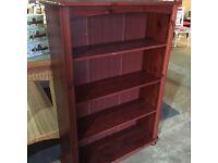 Dark stained pine bookcase