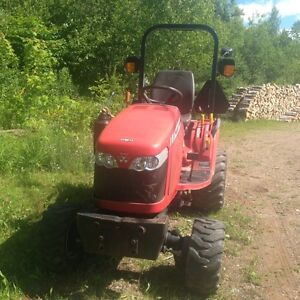 Tractor, snow blower and plow for sale.