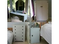 4 piece bedroom set painted in a shabby chic style.