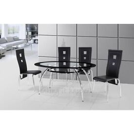 Oval glass table and 4 black leather chairs