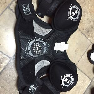Boys hockey equipment, shoulder pads and pants