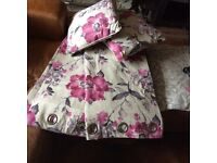 Dunelm floral curtains and pair of cushions.
