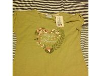 Lovely brand new green Help for Heroes Tshirt with green floral heart logo to front, size 10