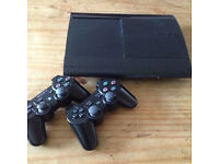 Playstation 3 with 2 controllers and a charger