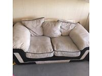 Cream sofa and spinning chair