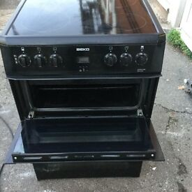 60 cm black Beko electric cooker in mint condition with a warranty