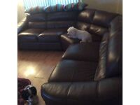 Brown leather corner sofa with poofy