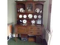 Edwardian oak dresser with stained glass cupboard