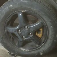 4- 4 bolt Acura rims and tires