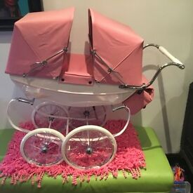 Dolls pink twin Silvercross pram