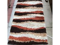 Small brown and orange rug