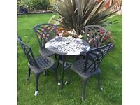 Cast metal garden table & chairs