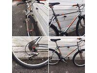 Orange hard tail mountain bike 1992