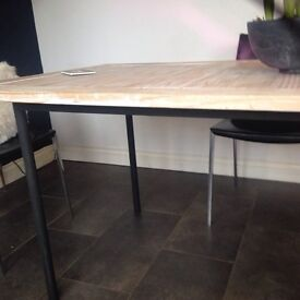 Contemporary table in wood and metal