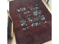 Brown leather patch handmade rug