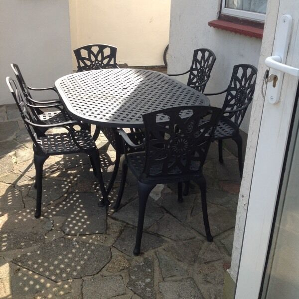 CAST ALUMINIUM GARDEN TABLE AND 6 CARVER CHAIRS BLACKin Romford, LondonGumtree - Table is 6ft long by 31/2ft wide, good condition with a lovely pattern, very well made, ready for the summer, 6 carver chairs, cash on collection from romford essex, local delivery may be possible if viewed and paid for beforehand, priced to sell,...