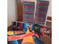 75 CDs and corresponding books for sale