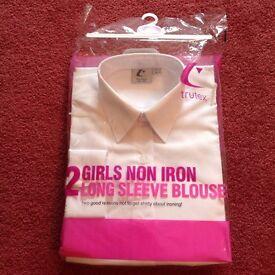 Girls long sleeve white blouses.