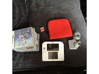 Red Nintendo 2DS with case and 6 games