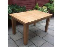 100% Solid Oak Extending Dining Table.