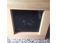 Designer electric fire with light oak surround ( can deliver )