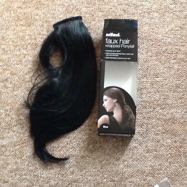 Scunci Fau Hair wrapped ponytail
