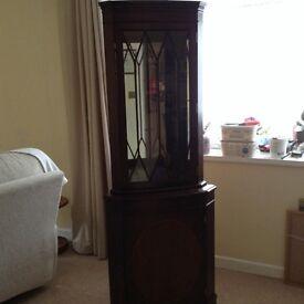 Dark wood corner display unit