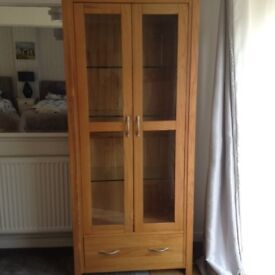 Solid oak glass display cost £650 except £180
