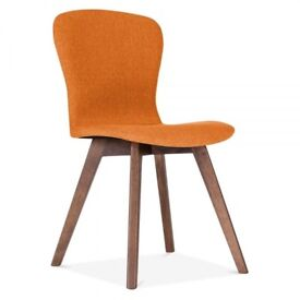 Beautiful orange fabric chairs with wooden legs