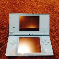 Blue DSI, charger, 2 cases and 8 games