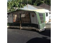 Adria 2 berth caravan with motor mover, full awning and porch awning.
