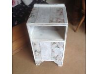 Vintage shabby chic bedside table.