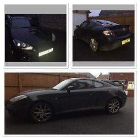 Black Hyundai coupe SIII