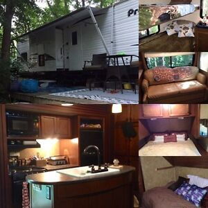 Travel trailer 33' sleeps 8-10.