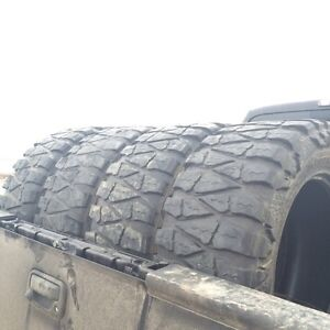 Four 35x12.5R20 Nitto Mud Grapplers