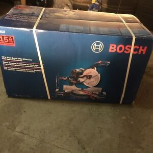 """New in box 12"""" dual bevel compound sliding mitre saw by Bosch"""