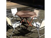 Solid wood octagonal garden/patio table & 4 folding chairs Delivery available