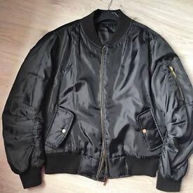 Boohoo women's Black Bomber jacket.