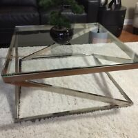 Steel cocktail/coffee table with glass top